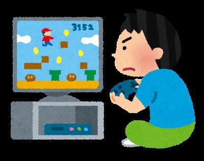 家庭用ゲーム機でゲームをする男性